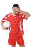 сформируйте осадку футбола игрока красную Стоковые Изображения RF