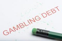 Сформулируйте ` задолженности ` играя в азартные игры с worn ластиком и Shavings карандаша Стоковое фото RF
