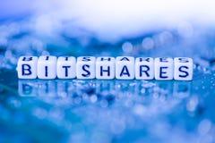 Сформулируйте BITSHARES сформированное блоками алфавита на cryptocurrency матери стоковое фото