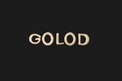 Сформулируйте golod сделанное от изолированного теста печенья на черноте Стоковые Изображения RF