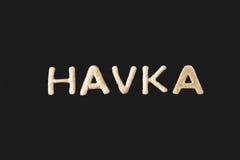 Сформулируйте havka сделанное от изолированного теста печенья на черноте Стоковые Фотографии RF