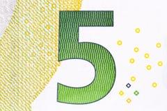 Сфотографированный номер в евро 5 банкнот стоковое фото