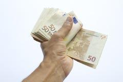 Схематическая банкнота бумажных денег евро в руке человека или человека Стоковое Изображение