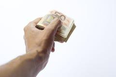Схематическая банкнота бумажных денег евро в руке человека или человека Стоковые Фото