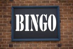 Схематическая воодушевленность титра текста сочинительства руки показывая Bingo объявления Концепция дела для помечать буквами иг стоковое фото rf