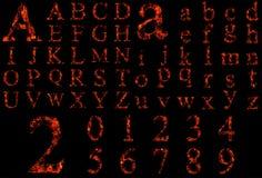 Схематические шрифты огня горения красного цвета изолированные на черноте Стоковая Фотография