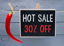 Схематический горячий знак продажи с перцем красного chili Стоковая Фотография