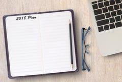 Схематическое дело тетради, портативного компьютера с планом 2018 Стоковая Фотография