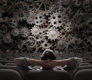 Схематическое изображение бизнесмена смотря на работе Стоковое Изображение RF