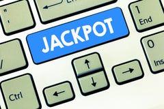 Схематическое сочинительство руки показывая джэкпот Приз наличных денег текста фото дела большой в связанный играть в азартные иг стоковое фото