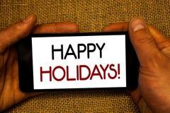 Схематическое сочинительство руки показывая звонок счастливых праздников мотивационный Приветствие текста фото дела празднуя праз стоковые изображения rf