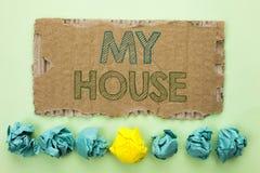 Схематическое сочинительство руки показывая мой дом Writte имущества домочадца семьи свойства дома снабжения жилищем текста фото  Стоковое Изображение