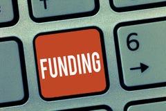 Схематическое сочинительство руки показывая финансирование Деньги фото дела showcasing обеспеченные правительством организации дл стоковое изображение