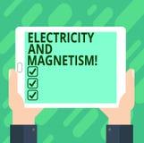 Схематическое сочинительство руки показывая электричество и магнетизм Текст фото дела овеществляет одиночную электромагнитную сил стоковая фотография