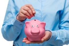 Схематическое фото - деньги сбережений Конец-вверх Хана Стоковые Фотографии RF