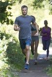 Сценарная трасса jog для 3 бегунов Стоковое Изображение