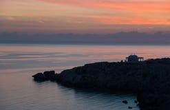 Сцена восхода солнца на накидке Greco стоковые фото