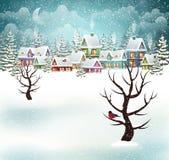Сцена деревни зимы вечера Стоковое Изображение