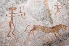 Сцена животного звероловства выполнила ocher на стене пещеры иллюстрация вектора