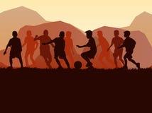 Сцена природы ребенк футбола силуэта Стоковая Фотография
