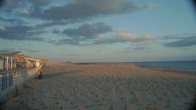Сцена пляжа во время захода солнца Стоковая Фотография