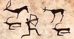 Сцена старого звероловства ` s человека в пещере стоковое изображение