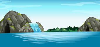 Сцена с водопадом и пещерой Стоковые Фото