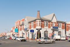 Сцена улицы с историческими зданиями и кораблями в Swakopmund Стоковые Изображения