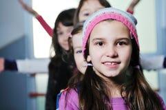 Счастливая группа детей в школе Стоковое фото RF