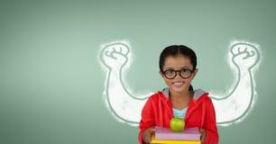 Счастливая девушка студента при график кулаков стоя против зеленой предпосылки Стоковые Изображения RF