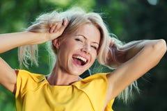Счастливая женщина в пуще стоковое фото rf