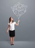 Счастливая женщина держа ся рисовать воздушных шаров Стоковая Фотография RF