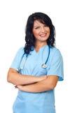 Счастливая женщина доктора при сложенные рукоятки Стоковые Изображения