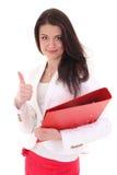 Счастливая женщина при скоросшиватель показывая одобренный знак Стоковое Изображение