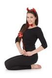 Счастливая женщина kneeling в costume дьявола Стоковые Изображения