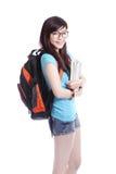 Счастливая книга и усмешка holdng студента девушки Стоковые Изображения RF