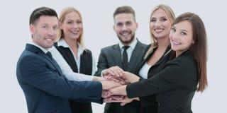 Счастливая команда дела показывая единство с их руками совместно Стоковое Изображение RF