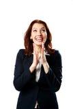Счастливая коммерсантка аплодируя стоковая фотография