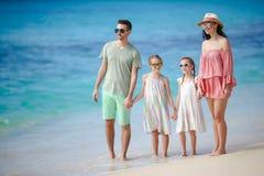 Счастливая красивая семья на пляже Стоковая Фотография RF