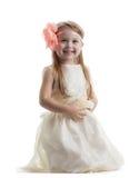 Счастливая маленькая девочка в длиннем платье стоковое изображение rf