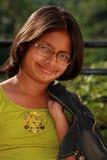Счастливая молодая азиатская девушка Стоковая Фотография RF
