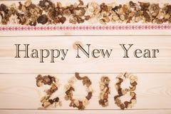 Счастливая надпись 2018 Нового Года высушенных цветков Стоковые Изображения