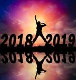 Счастливая предпосылка захода солнца силуэта Нового Года стоковое фото