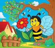 Счастливая пчела держа тему 2 цветка Стоковое фото RF