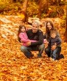 Счастливая семья в осенней пуще Стоковое фото RF