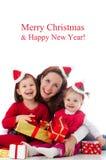 Счастливая семья празднуя рождество Стоковые Фотографии RF