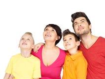 Счастливая семья при 2 дет смотря вверх Стоковое фото RF