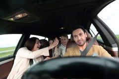 Счастливая семья путешествуя автомобилем Стоковая Фотография
