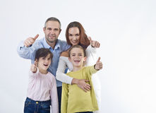Счастливая семья с большими пальцами руки вверх Стоковые Изображения