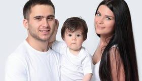 Счастливая семья с newborn младенцем на белой предпосылке Стоковая Фотография